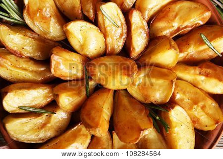 Baked potato wedges on table, top view