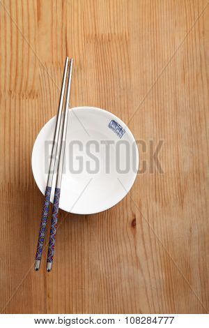 empty chinese rice bowl with chopstick