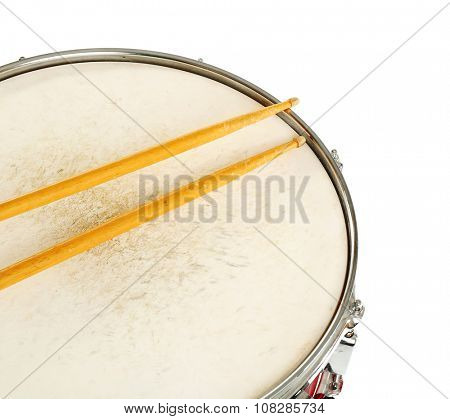 Red drum with drum sticks isolated on white background, close up