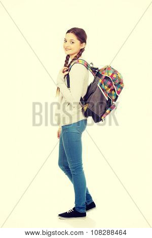 Happy beautiful teen woman with backpack.