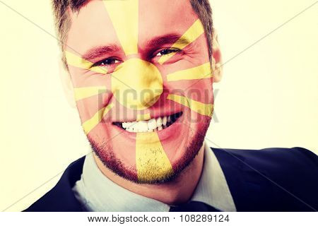 Happy man with Macedonia flag painted on face.