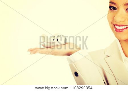 African businesswoman holding small plane on palm.