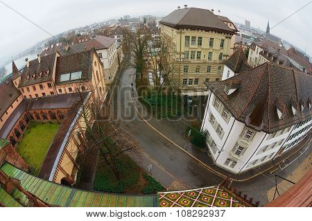 View to the historical buildings from Munster tower on a rainy day in Basel, Switzerland.