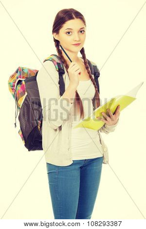 Teenager girl with school backpack and pencil.