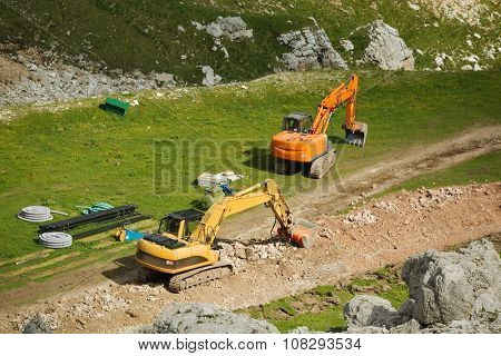 Excavators working on a ski slope