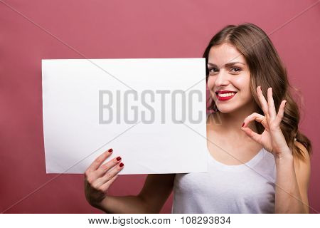 Beautiful Woman Holding A Banner
