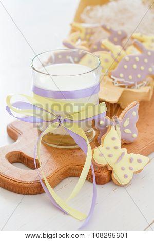 Easter cookies in egg holder, milk