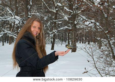 The Beautiful Girl Feeds A Bird