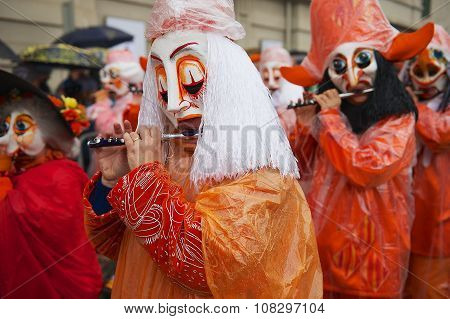 People play flutes at Basel Carnival in Basel, Switzerland.
