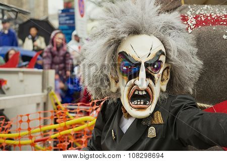 Person wears carnival mask at Basel Carnival in Basel, Switzerland.