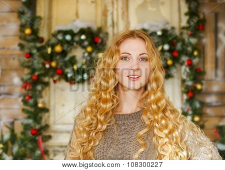 Happy Young Woman By The Christmas Decorations