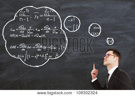 Businessman Solves The Equation And Has Idea Concept