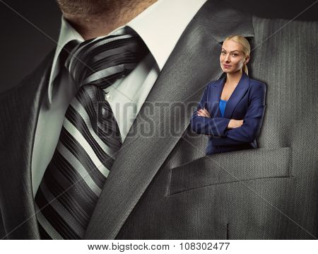 Small blond businesswoman in gray male suit pocket