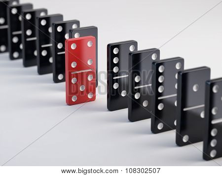 Unique red domino tile and black dominoes
