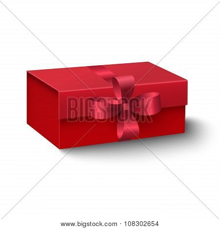 Closeup View Of Red Oblong Gift Box With Red Ribbon And Bow Isolated On White