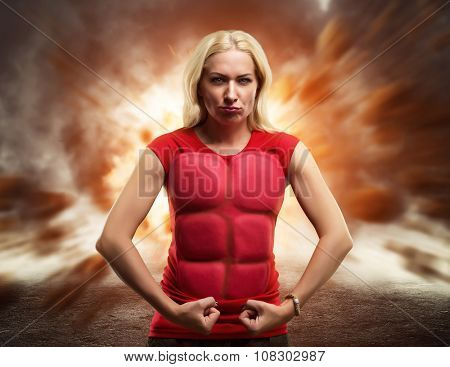 Strong woman superhero showing off her strength against burst of light