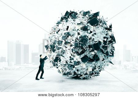 Businessman Trying To Push A Ball Of Office Accessories, Overworked Concept