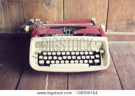 Old Style Typewriter On A Wooden Floor