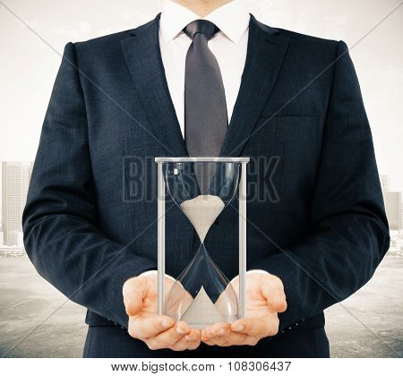 Businessman Shows Hourglass, Time Concept