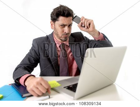 Businessman At Office Working Stressed On Computer Holding Mobile Phone