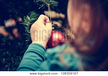 Little Girl Is Decorating Christmas Tree In Retro Filter Effect Or Instagram Filter