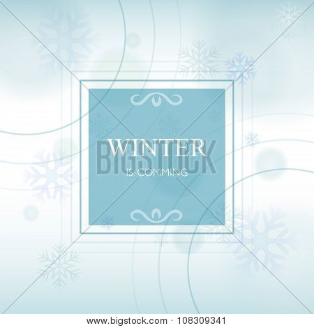 Winter Is Comming In Frame Over Light Blue Background With Snowflakes