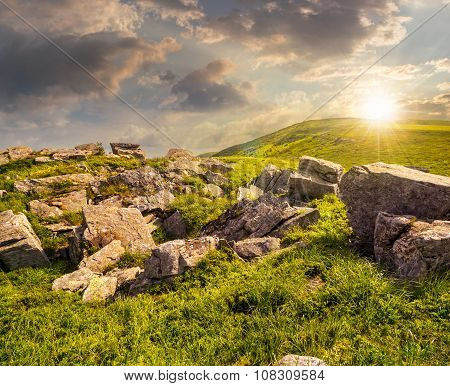 Boulders On The Mountain Meadow At Sunset