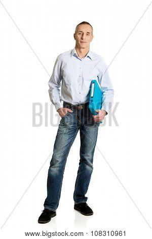 Handsome mature man holding blue binder.