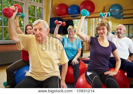 Senior People Working Out With Dumbbells