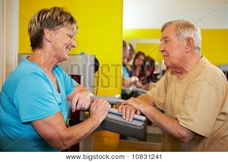 Senior People Flirting In Gym