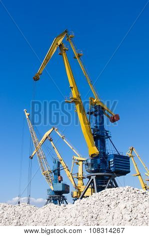 Harbour Cranes On Loading In Sea Port