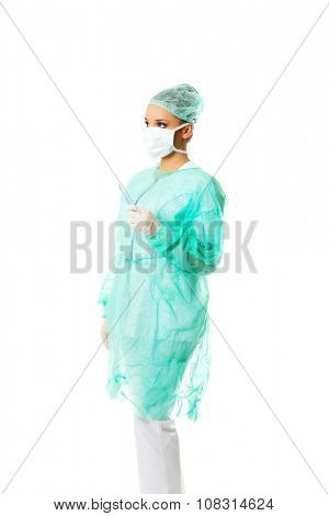 Side view female doctor with a scalpel.