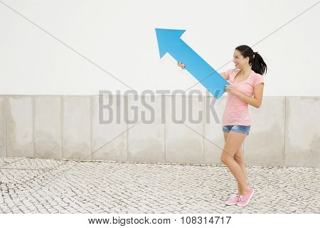 School concept - Teenage student holding a blue arrows