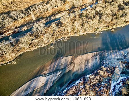 aerial view of South Platte River in eastern Colorado with a canoe on sandbar, fall scenery