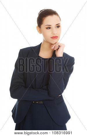Thinking businesswoman standing pensive contemplating.