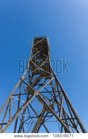 High Metal Tower On Blue Sky Background