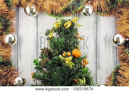 New Year Theme Christmas Tree With Golden And Green Decoration And Silver Balls On White Retro Styli