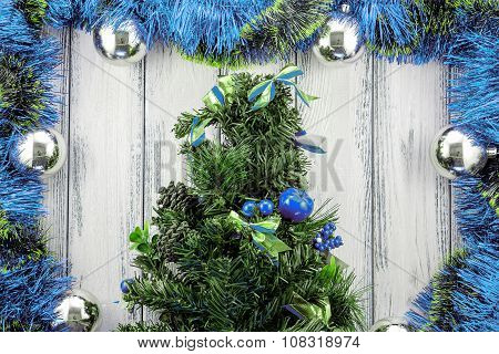 New Year Theme Christmas Tree With Blue And Green Decoration And Silver Balls On White Retro Stylize