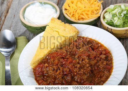 Chili with cornbread and fixings