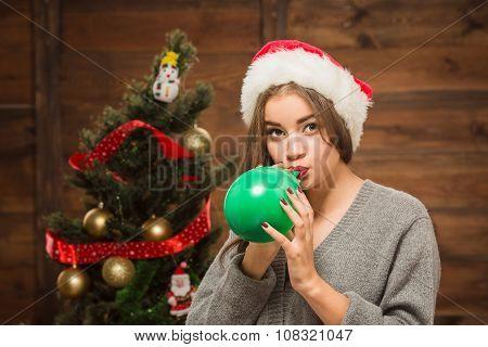 Beautiful girl blowing a baloon
