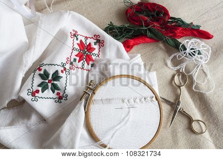 Openwork embroidery, incomplete work in progress and tools for embroidery