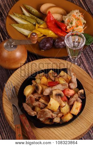 Roast With A Potato, Meat And Mushrooms And A Vodka Wine-glass