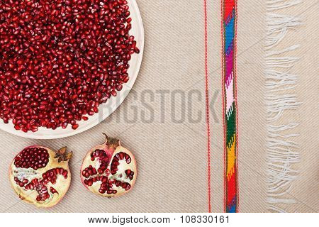 Full plate of peeled pomegranate seeds good for healthy and proper nutrition
