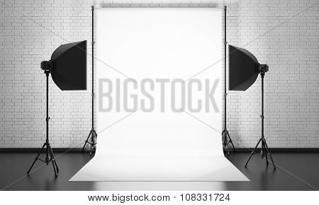 Photo Studio Equipment On A Brick Wall Background. 3D.