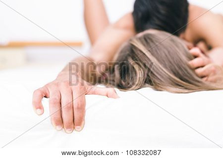 Young Couple Having Romantic Fun In Bed