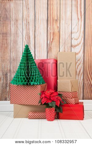 Christmas gifts in interior with blue wall paper