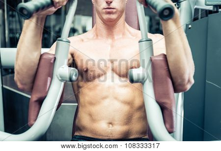 Close Up On An Athlete Chest While Making Workout