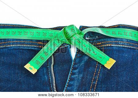 Jeans and measuring tape - slimming concept - isolated on white background