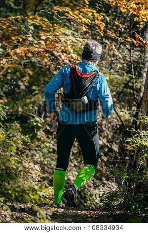 young athlete man running mountain marathon