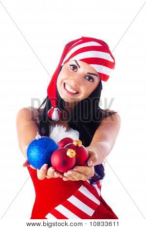 Santa Girl Holding A Christmas Ball, Christmas Toys. Holidays New Year And Christmas